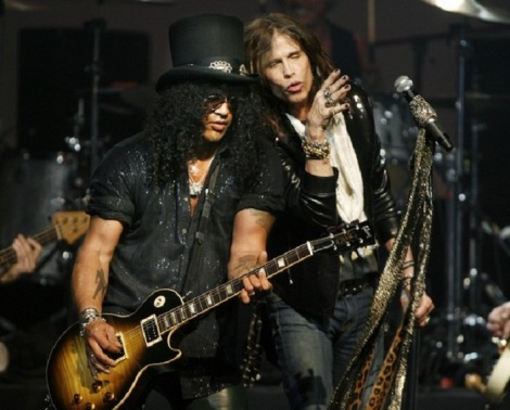 Rock guitarist Slash performs with Steven Tyler of Aerosmith at the MusiCares MAP Fund benefit concert in Hollywood